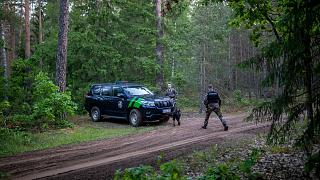 Members of the Lithuania State Border Guard Service patrol on the border with Belarus on  June 10, 2021.
