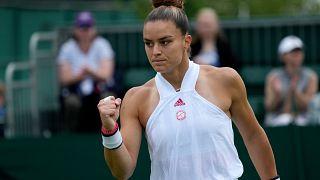 Maria Sakkari of Greece celebrates winning a point against Netherland's Arantxa Rus