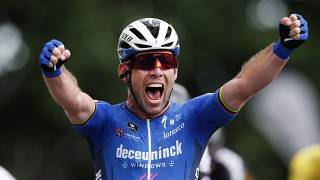 Britain's Mark Cavendish celebrates as he crosses the finish line to win the fourth stage of the Tour de France on June 29, 2021.