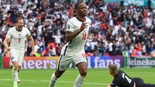 Raheem Sterling celebrates scoring against Germany