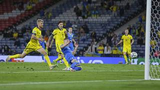 Ukraine's Artem Dovbyk scores his team's winning goal during the Euro 2020 round of 16 match between Sweden and Ukraine at Hampden Park in Glasgow, Tuesday, June 29, 2021.