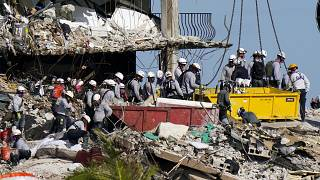 workers search the rubble at the Champlain Towers South Condo in Surfside, Fla. on June 28, 2021.