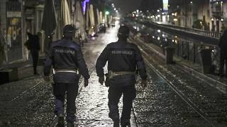 Two city police officers patrol the Navigli area of Milan.