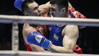 Kazakhstan's Kamshybek Kunkabayev (R) fights with Uzbekistan's Bakhodir Jalolov during the AIBA men's super heavy weight final in Yekaterinburg, Russia, Sept. 21, 2019.