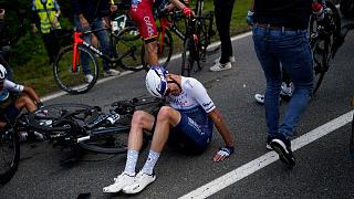 Britain's Chris Froome lays on the road after crashing during the first stage of the Tour de France cycling race over 197.8 kilometres 26 June 2021.