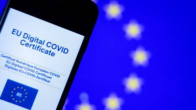 A picture taken on June 16, 2021 in Brussels shows the screen of a mobile phone bearing a EU Digital Covid certificate.