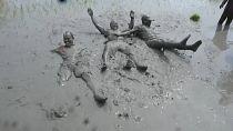 Nepal farmers jump into muddy fields to celebrate rice festival