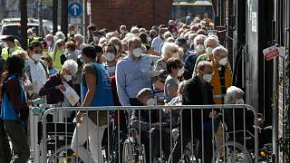 People line up in front of the vaccination centre at the Arena Treptow in Berlin, Germany, March 31, 2016.