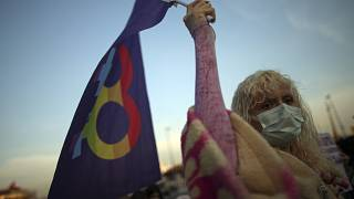 A protester holds a flag during an April demonstration against Turkey's withdrawal in Istanbul.