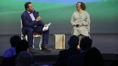 Arnold Schwarzenegger and Lisa Jackson from Apple at the Austrian World Summit this week.