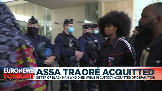 Assa Traoré surrounded by supporters and lawyer in front of the court in Pontoise.