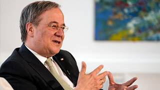 Governor of North Rhine-Westphalia Armin Laschet gestures during an interview with the Associated Press at his office in Duesseldorf, Germany, Wednesday, June 30, 2021.