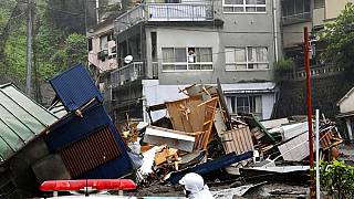 Dozens feared missing after mudslide tears through town in Japan