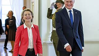 Lithuania's President Gitanas Nauseda and European Commission President Ursula von der Leyen, left, arrive for their meeting at the Presidential palace in Vilnius, Lithuania,