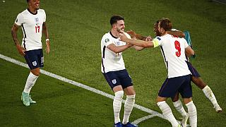 England's Harry Kane, right, celebrates after scoring his side's third goal during the Euro 2020 soccer championship quarterfinal match between Ukraine and England.