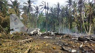 The remains of a Philippine military C-130 plane that crashed in Patikul town, Jolo province, southern Philippines on Sunday, July 4, 2021.