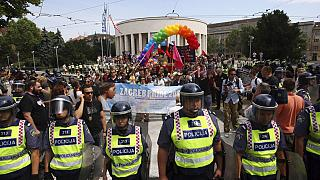 Police protect participants as they take part in the Gay Pride march in Zagreb, Croatia, Saturday, June 18, 2011.