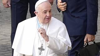 In this June 30, 2021 file photo, Pope Francis arrives for his weekly general audience with a limited number of faithful in the San Damaso Courtyard at the Vatican.
