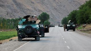 Afghan soldiers pause on a road at the front line of fighting between Taliban and Security forces, near the city of Badakhshan, northern Afghanistan, Sunday, July. 4, 2021