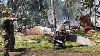 Parts of a Lockheed C-130 Hercules plane at the crash site in Patikul town, Sulu province