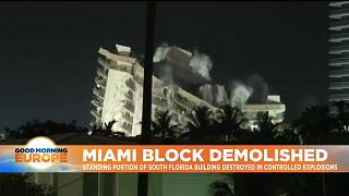 Still-standing portion of collapsed South Florida building being demolished.