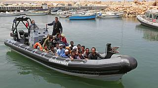 Migrants rescued by Tunisia's national guard from the Mediterranean arrive at the port of el-Ketef near the Libyan border, June 27, 2021.