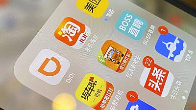 The ride-hailing app Didi is seen near other Chinese apps on a phone in Beijing