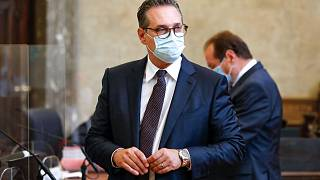 Heinz-Christian Strache waits for the start of a trial in a courtroom in Vienna.