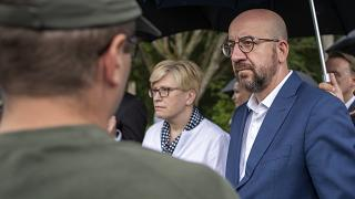 European Council President Charles Michel and Lithuania's Prime Minister Ingrida Simonyte talk  with members of the Lithuania State Border Guard connected  Tuesday.