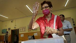 A woman reacts after casting her vote in Sofia on Sunday