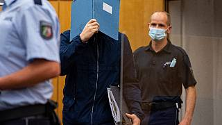 The main   suspect  hid his look   arsenic  helium  arrives for sentencing astatine  the tribunal  successful  Münster.