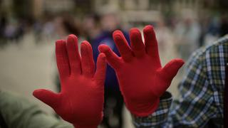 Protestors wearing red gloves take part in a protest against male sexual violence in Pamplona in 2018.