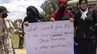 Women protest ahead of a vote by Israel's parliament on renewing a law that bars Arab citizens of Israel from extending citizenship or even residency to spouses.