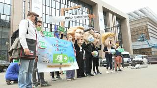 Protesters against the Energy Charter Treaty