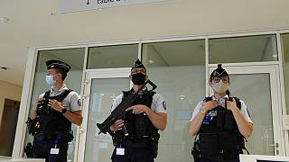 FILE PHOTO: Police officers guard the Palace of Justice Thursday, June 3, 2021 in Paris, France.