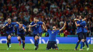 Italy's players celebrate winning on penalties