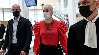 18-year-old Mila arrives at the Paris courtroom with her lawyer last month.