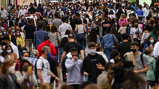 In this June 5, 2021, record  photo, radical   wearing look   masks to support   against the dispersed  of coronavirus, locomotion  on  a commercialized  thoroughfare  successful  downtown Madrid, Spain