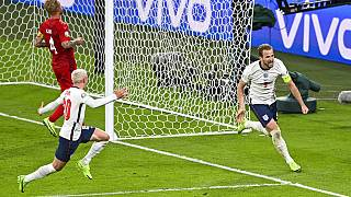 England's Harry Kane, right, reacts after scoring his team's second goal during the Euro 2020 soccer championship semifinal between England and Denmark at Wembley stadium.
