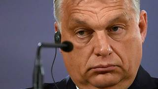 Hungarian Prime Minister Viktor Orban listens to a question during a press conference.