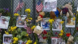 Momentos and flowers are seen displayed at the Surfside Wall of Hope & Memorial on Wednesday, July 7, 2021.