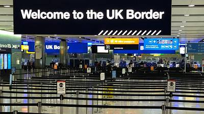 A UK border sign welcomes passengers on arrival at Heathrow airport in west London