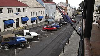 FILE: Vehicles are parked along a neat row in downtown Jamestown, capital of St. Helena island, 2017.
