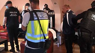 Spanish police raid a premises linked to the criminal gang in February 2021.