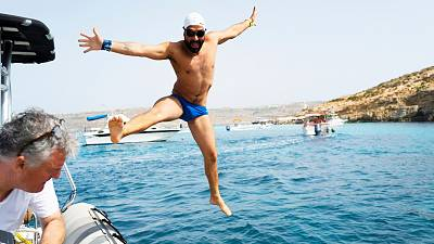 Neil Agius dives off for his world-record breaking swim.