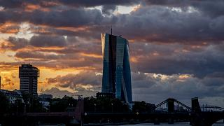 The sun rises behind the European Central Bank in Frankfurt, Germany.
