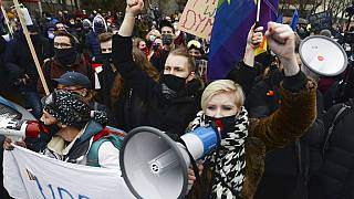 Women protest the newly-introduced, prohibitive abortion law Warsaw on January 27, 2021