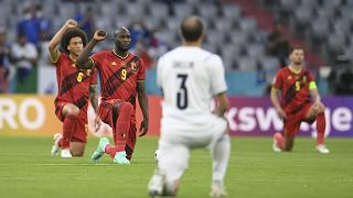 Players take a knee before a Euro 2020 match between Belgium and Italy.