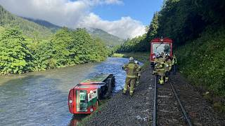 One of the train's crriages had fallen four metres into the river Mur.