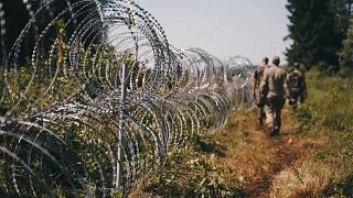 Members of Lithuania's border guard have begun installing a barbed wire fence on the Lithuanian side of the border with Belarus, according to footage released by the Lithuania
